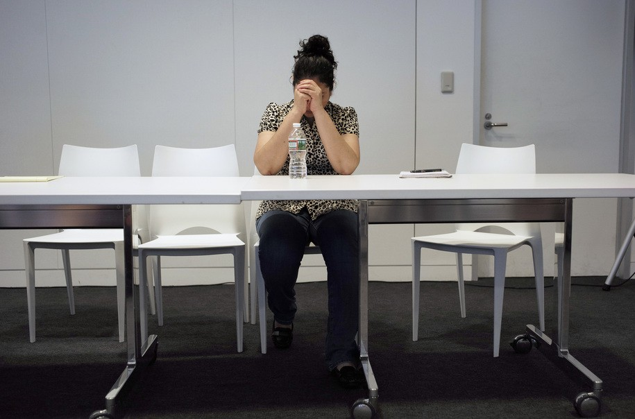 A mother from Guatemala, identified only by initials, L.J., who was separated from her two children after entering the U.S. in May of 2018, sits at a table after speaking to reporters about the separation during a news conference, Thursday, Sept. 6, 2018, in Boston. L.J. is among plaintiffs in a lawsuit against President Donald Trump's administration, seeking monetary damages on behalf of children who were separated from their parents at the border. (AP Photo/Steven Senne)
