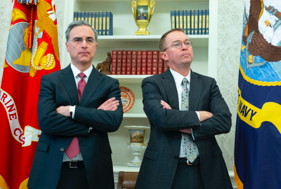 White House Counsel Pat Cipollone (L) and Director of the Office of Management and Budget and Acting Director of the Consumer Financial Protection Bureau Mick Mulvaney (R) attend a meeting between US President Donald J. Trump and US House Speaker-designate Nancy Pelosi and US Senate Minority Leader Chuck Schumer, in the Oval Office of the White House in Washington, DC, USA, 11 December 2018. Trump, Pelosi and Schumer had a disagreement on border policy and shutting down the government. Credit: Michael Reynolds / Pool via CNP | usage worldwide Photo by: Michael Reynolds/picture-alliance/dpa/AP Images