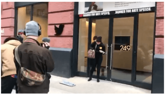 Laura Loomer chained to the doors at Twitter