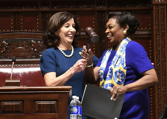 New York Lt. Gov Kathy Hochul, left, gives the Senate gavel to Senate Majority Leader Andrea Stewart-Cousins, D-Yonkers, as she speaks to members of the state Senate during opening day of the 2019 legislative session in the Senate Chamber of the Capitol, Wednesday, Jan. 9, 2019, in Albany, N.Y. (AP Photo/Hans Pennink)