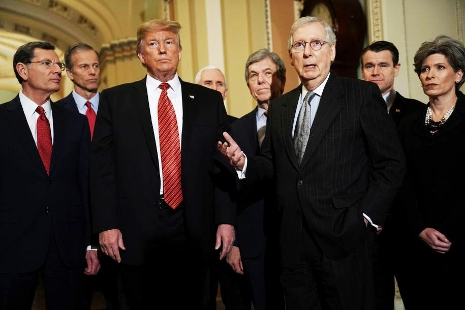 WASHINGTON, DC - JANUARY 09: U.S. Senate Majority Leader Sen. Mitch McConnell (R-KY) (3rd R) speaks to members of the media as (L-R) Sen. John Barrasso (R-WY), Sen. John Thune (R-SD), President Donald Trump, Vice President Mike Pence, Sen. Roy Blunt (R-MO), Sen. Todd Young (R-IN) and Sen. Joni Ernst (R-IA) listen at the U.S. Capitol after the weekly Republican Senate policy luncheon January 09, 2019 in Washington, DC. Trump met with GOP lawmakers to shore up their resolve and support for his proposed border wall with Mexico as the partial federal government shutdown drags into a third week. (Photo by Alex Wong/Getty Images