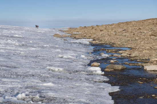At the boundary of ice and rock on Baffin Island in the Canadian Arctic, scientists from the University of Colorado Institute of Arctic and Alpine Research confer.
