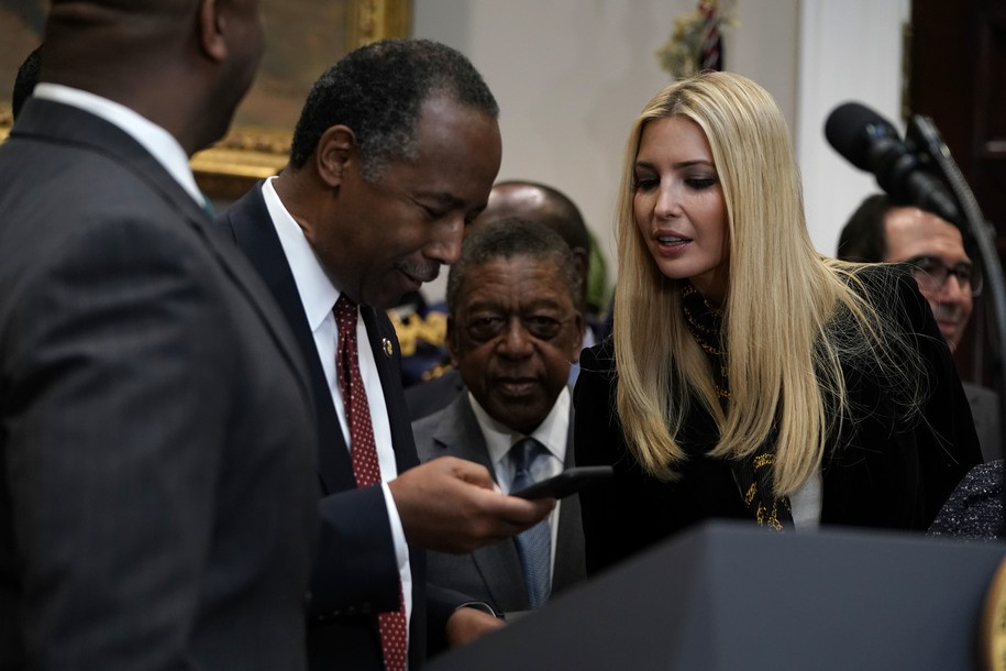 WASHINGTON, DC - DECEMBER 12: White House adviser Ivanka Trump (R), daughter of U.S. President Donald Trump, shares a moment with Secretary of Housing and Urban Development Secretary Ben Carson (L) during a signing event of an executive order to establish the White House Opportunity and Revitalization Council look on December 12, 2018 at the Roosevelt Room of the White House in Washington, DC. The creation of the council will oversee the opportunity zones program and it will be chaired by Secretary of Housing and Urban Development Secretary Ben Carson. (Photo by Alex Wong/Getty Images)