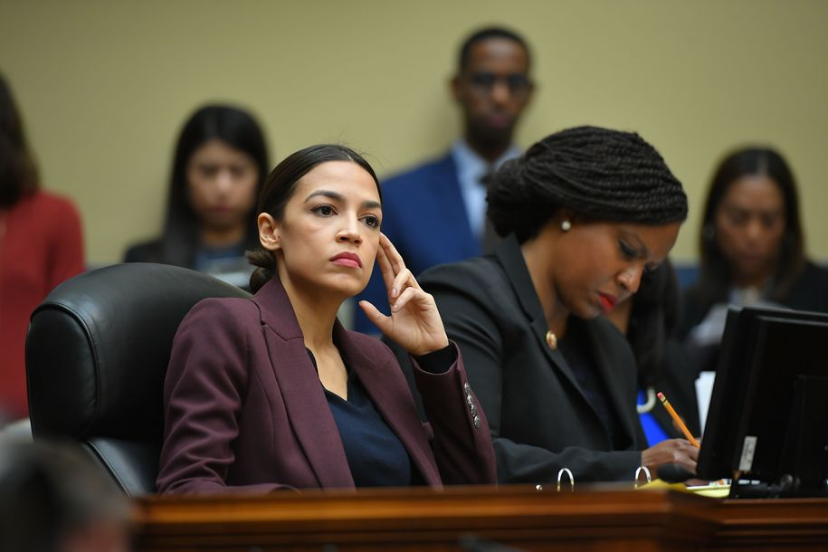 US Congresswoman Alexandria Ocasio-Cortez(D-NY) listens as Michael Cohen, attorney for President Trump, testifies before the House Oversight and Reform Committee in the Rayburn House Office Building on Capitol Hill in Washington, DC on February 27, 2019. (Photo by MANDEL NGAN / AFP) (Photo credit should read MANDEL NGAN/AFP/Getty Images)