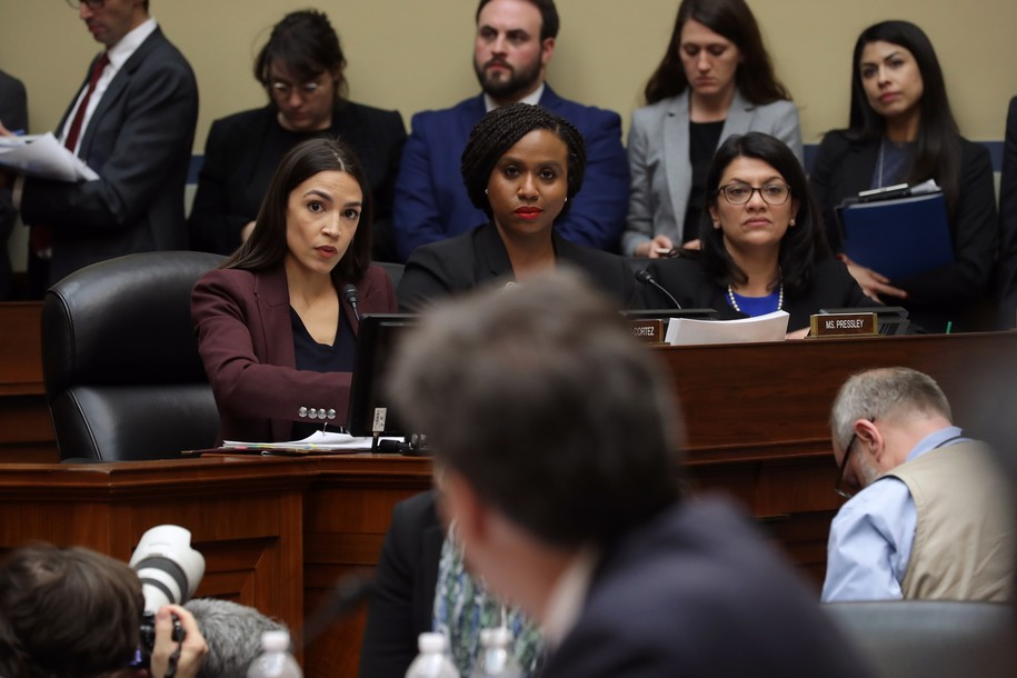 WASHINGTON, DC - FEBRUARY 27: (L-R) Rep. Alexandria Ocasio-Cortez (D-NY), Rep. Ayanna Pressley (D-MA) and Rep. Rashida Tlaib (D-MI) listen as Michael Cohen, former attorney and fixer for President Donald Trump, testifies before the House Oversight Committee on Capitol Hill February 27, 2019 in Washington, DC. Last year Cohen was sentenced to three years in prison and ordered to pay a $50,000 fine for tax evasion, making false statements to a financial institution, unlawful excessive campaign contributions and lying to Congress as part of special counsel Robert Mueller's investigation into Russian meddling in the 2016 presidential elections. (Photo by Chip Somodevilla/Getty Images)