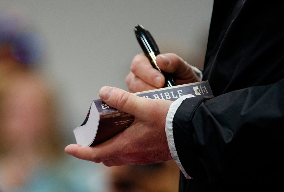 Working in mysterious ways, Trump signs Bibles in Alabama