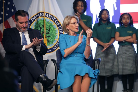 """WASHINGTON, DC - FEBRUARY 28:  U.S. Education Secretary Betsy DeVos (R) and Sen. Ted Cruz (R-TX) participate in an event to promote their proposal for Education Freedom Scholarships at the Education Department headquarters February 28, 2019 in Washington, DC.  According to the department, the scholarships will be funded with $5 billion of federal tax credit for donations to scholarships for private schools and other educational programs and would """"significantly expand education freedom for millions of students and families across the country.""""  (Photo by Chip Somodevilla/Getty Images)"""