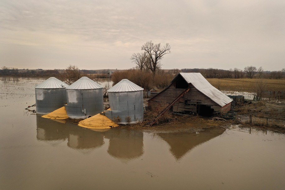 "UNION, NEBRASKA - MARCH 23: Corn burst from a grain bin which was soaked with floodwater on March 23, 2019 near Union, Nebraska. Damage estimates from flooding in Nebraska top $1 billion. Midwest states are battling some of the worst flooding they have experienced in decades as rain and snow melt from the recent ""bomb cyclone"" that has inundated rivers and streams. At least three deaths have been linked to the flooding. (Photo by Scott Olson/Getty Images)"