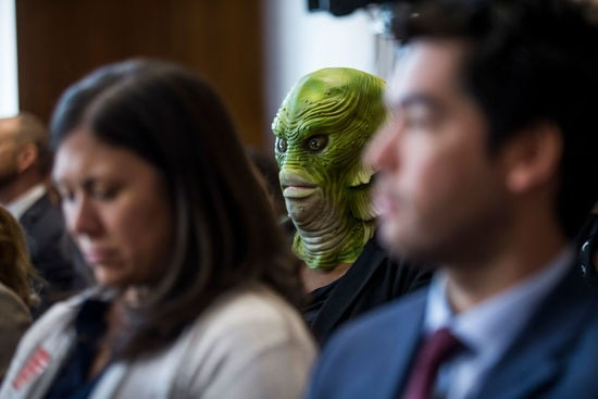 WASHINGTON, DC - MARCH 28: A demonstrator wears a Creature from the Black Lagoon mask as David Bernhardt, President Donald Trump's nominee to be Interior Secretary, testifies during a Senate Energy and Natural Resources Committee confirmation hearing on March 28, 2019 in Washington, DC. (Photo by Zach Gibson/Getty Images)