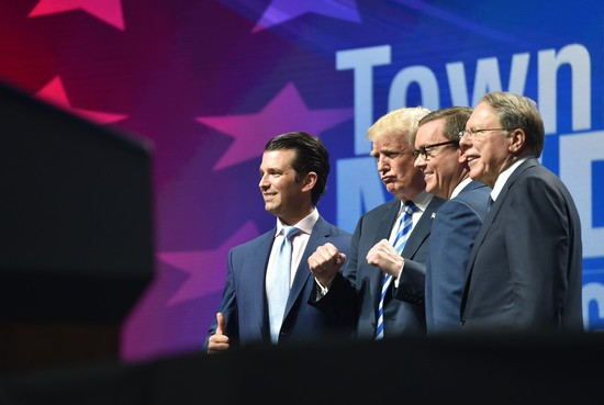US President Donald Trump(C) arrives speak to speak at the NRA's annual convention on May 4, 2018 at the Kay Bailey Hutchison Convention Center in Dallas, Texas as he stands with son Donald Trump Jr.(L), and National Rifle Association chief Wayne LaPierre(R). (Photo by Nicholas Kamm / AFP)        (Photo credit should read NICHOLAS KAMM/AFP/Getty Images)