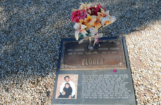The grave of Brisenia and Raul Flores.