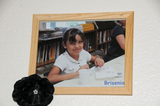 A photo of Brisenia Flores hangs in the Arivaca community center where she used to play.