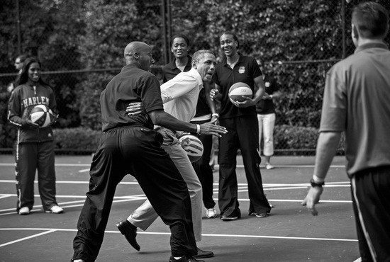 BLACK AND WHITE VERSION - US President Barack Obama plays basketball with former NBA player Bruce Bowen during the annual Easter Egg Roll on the South Lawn of the White House April 9, 2012 in Washington, DC. The First Family participated in the yearly event where the South Lawn is opened up to guests to participate in various egg rolls and other activities. AFP PHOTO/Brendan SMIALOWSKI (Photo credit should read BRENDAN SMIALOWSKI/AFP/GettyImages)