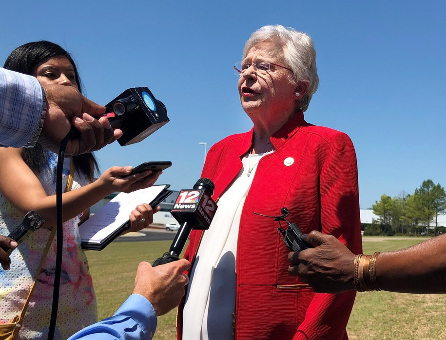 Alabama Gov. Kay Ivey discusses a bill that would virtually outlaw abortion in the state while visiting a car factory at Montgomery, Ala., on Wednesday, May 15, 2019. Ivey, who has described herself as opposing abortion, said she has not yet reviewed the legislation or made a decision on whether to sign it. (AP Photo/Blake Paterson)