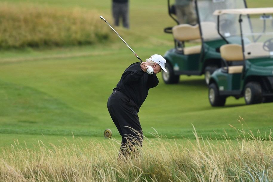 TURNBERRY, SCOTLAND - JULY 15:  U.S. President Donald Trump hits a tee shot whilst playing a round of golf at Trump Turnberry Luxury Collection Resortduring the U.S. President's first official visit to the United Kingdom on July 15, 2018 in Turnberry, Scotland. The President of the United States and First Lady, Melania Trump on their first official visit to the UK after yesterday's meetings with the Prime Minister and the Queen is in Scotland for private weekend stay at his Turnberry.  (Photo by Leon Neal/Getty Images)