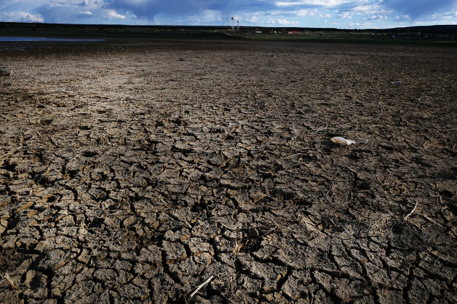 THOREAU, NEW MEXICO - JUNE 06: A dried out lake stands near the Navajo Nation town of Thoreau on June 06, 2019 in Thoreau, New Mexico. Due to disputed water rights and other factors, up to 40 percent of Navajo Nation households don't have clean running water and are forced to rely on weekly and daily visits to water pumps. The problem for the Navajo Nation, a population of over 200,000 and the largest federally-recognized sovereign tribe in the U.S., is so significant that generations of families have never experienced indoor plumbing. Rising temperatures associated with global warming have worsened drought conditions on their lands over recent decades. The reservation consists of a 27,000-square-mile area of desert and high plains in New Mexico, southern Utah and Arizona. The Navajo Water Project, a nonprofit from the water advocacy group Dig Deep, has been working on Navajo lands in New Mexico since 2013 funding a mobile water delivery truck and digging and installing water tanks to individual homes. (Photo by Spencer Platt/Getty Images)