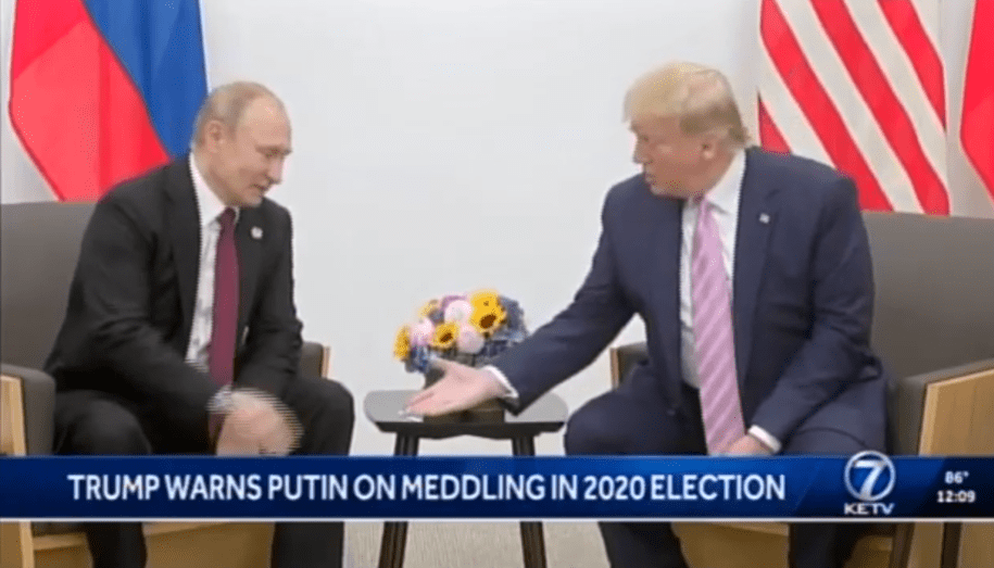 Trump caught on video applauding Vladimir Putin about 'fake news': 'You don't have that problem'