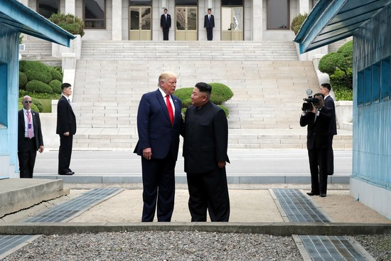 "PANMUNJOM, SOUTH KOREA - JUNE 30: (SOUTH KOREA OUT): A handout photo provided by Dong-A Ilbo of North Korean leader Kim Jong Un and U.S. President Donald Trump inside the demilitarized zone (DMZ) separating the South and North Korea on June 30, 2019 in Panmunjom, South Korea. U.S. President Donald Trump and North Korean leader Kim Jong-un briefly met at the Korean demilitarized zone (DMZ) on Sunday, with an intention to revitalize stalled nuclear talks and demonstrate the friendship between both countries. The encounter was the third time Trump and Kim have gotten together in person as both leaders have said they are committed to the ""complete denuclearization"" of the Korean peninsula. (Photo by Handout/Dong-A Ilbo via Getty Images)"