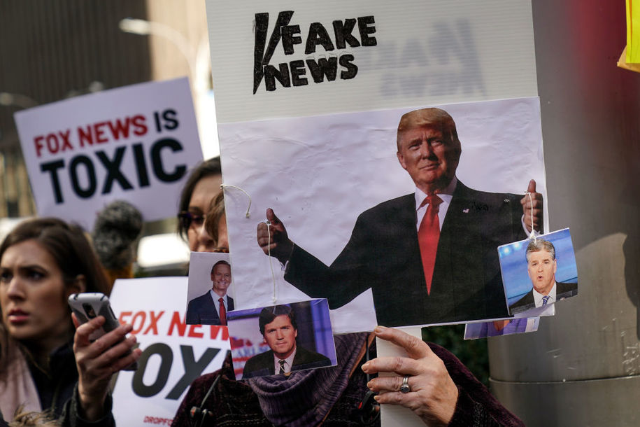 NEW YORK, NY - MARCH 13: Protesters rally against Fox News outside the Fox News headquarters at the News Corporation building, March 13, 2019 in New York City. On Wednesday the network's sales executives are hosting an event for advertisers to promote Fox News. Fox News personalities Tucker Carlson and Jeanine Pirro have come under criticism in recent weeks for controversial comments and multiple advertisers have pulled away from their shows. (Photo by Drew Angerer/Getty Images)