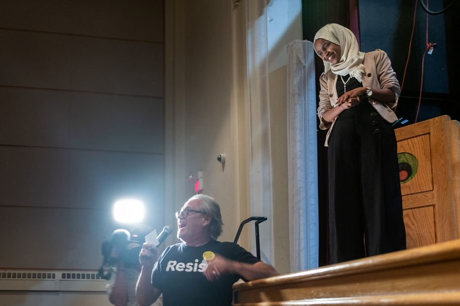 US Representative Ilhan Omar (D-MN) takes questions from the audience as she holds a Medicare for All town hall meeting at Sabathani Community in Minneapolis, Minnesota on July 18, 2019. (Photo by Kerem Yucel / AFP)        (Photo credit should read KEREM YUCEL/AFP/Getty Images)