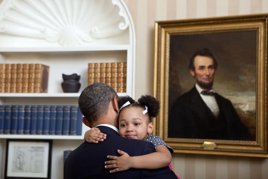 President Barack Obama holds Arianna Holmes, 3, before taking a departure photo with members of her family in the Oval Office, Feb. 1, 2012. Arianna