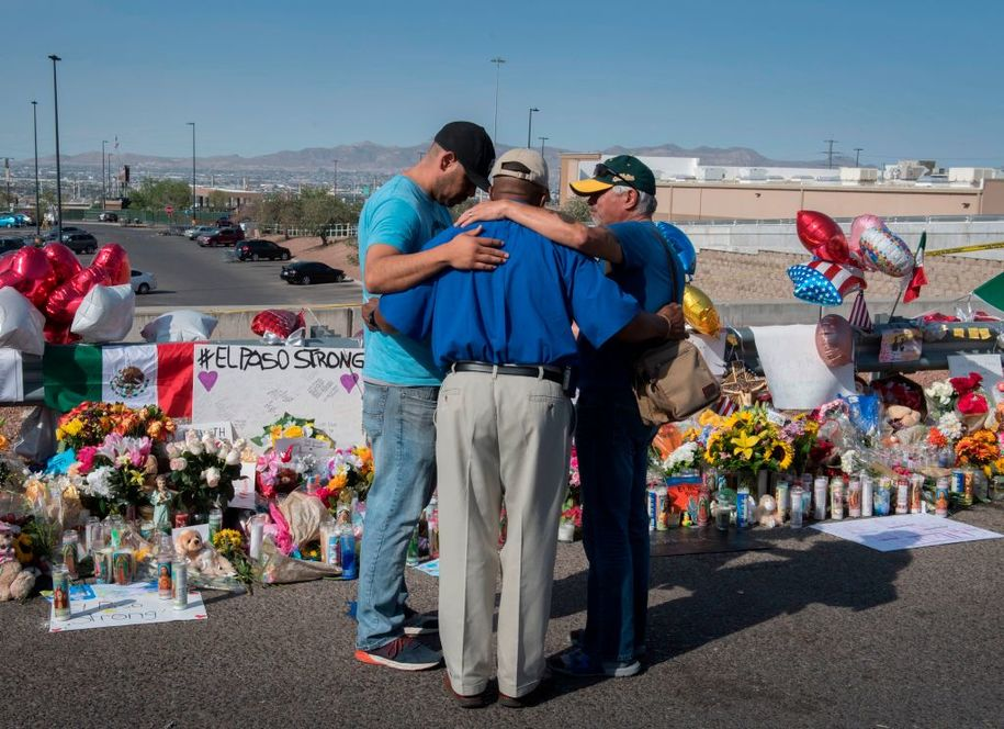 People pray at the makeshift memorial for victims of the shooting that left a total of 22 people dead at the Cielo Vista Mall Walmart, in El Paso, Texas, on August 7, 2019. (Photo by Mark RALSTON / AFP) (Photo credit should read MARK RALSTON/AFP/Getty Images)