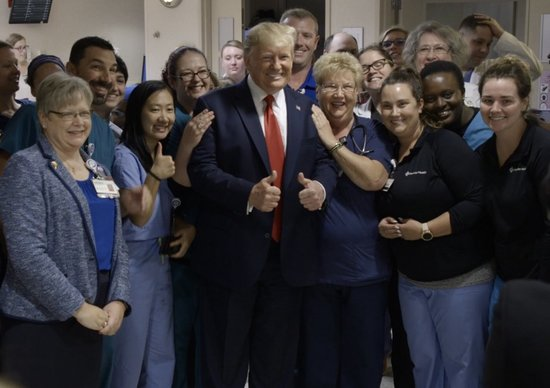 Donald Trump gleefully poses for photos at an El Paso hospital