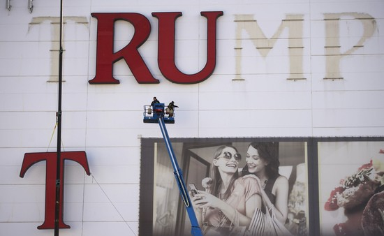 Letters are removed from the Trump Plaza Casino signage in Atlantic City, New Jersey October 24, 2014. The Taj Mahal was slated to close on Nov. 13 but said it would stay open for an unspecified period after winning benefit cuts in court. But state and local governments have balked at offering tax concessions. If the Taj closes, it will be the fifth of 12 casinos in the city to close amid fierce competition from casinos in neighboring states.  REUTERS/Mark Makela (UNITED STATES - Tags: TRAVEL BUSINESS SOCIETY TPX IMAGES OF THE DAY) - RTR4BJ3F