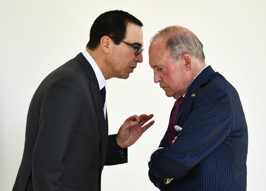 US Secretary of the Treasury Steven Mnuchin (L) speaks with White House Chief Economic Adviser Larry Kudlow after US President Donald Trump announced a new immigration proposal, in the Rose Garden of the White House in Washington, DC, on May 16, 2019. - Trump proposes an overhaul of US immigration to favor applicants with high skills and good English, while cutting back on family based arrivals and asylum seekers. (Photo by Brendan Smialowski / AFP) (Photo credit should read BRENDAN SMIALOWSKI/AFP/Getty Images)