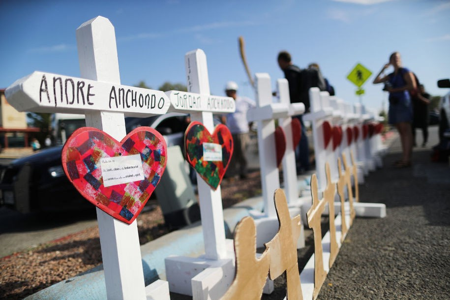 EL PASO, TEXAS - AUGUST 05: Handmade crosses memorializing the victims of a mass shooting, which left at least 22 people dead, are lined up before being carried to a nearby makeshift memorial on August 5, 2019 in El Paso, Texas. The crosses were made by retired carpenter Greg Zanis, who has made thousands of crosses for victims of mass shootings and disasters. A 21-year-old white male shooting suspect was taken into custody in the city which sits along the U.S.-Mexico border.  (Photo by Mario Tama/Getty Images)