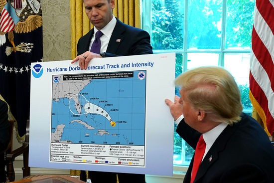 WASHINGTON, DC - SEPTEMBER 04: U.S. President Donald Trump (R) references a map held by acting Homeland Security Secretary Kevin McAleenan while talking to reporters following a briefing from officials about Hurricane Dorian in the Oval Office at the White House September 04, 2019 in Washington, DC. The map was a forecast from August 29 and appears to have been altered by a black marker to extend the hurricane's range to include Alabama. (Photo by Chip Somodevilla/Getty Images)