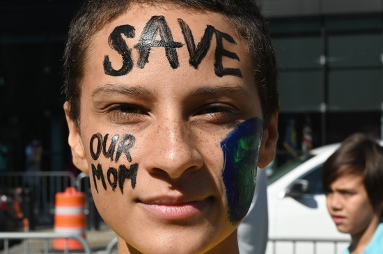 A student poses for a photograph  during the Global Climate Strike march at Foley Square in New York on September 20, 2019. - Crowds of children skipped school to join a global strike against climate change, heeding the rallying cry of teen activist Greta Thunberg and demanding adults act to stop environmental disaster. It was expected to be the biggest protest ever against the threat posed to the planet by climate change. (Photo by TIMOTHY A. CLARY / AFP)        (Photo credit should read TIMOTHY A. CLARY/AFP/Getty Images)