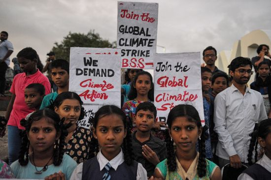 """Students hold placards as they participate in a climate strike to protest against governmental inaction towards climate breakdown and environmental pollution, part of demonstrations being held worldwide in a movement dubbed """"Fridays for Future"""" in Hyderabad on September 20, 2019. (Photo by NOAH SEELAM / AFP)        (Photo credit should read NOAH SEELAM/AFP/Getty Images)"""