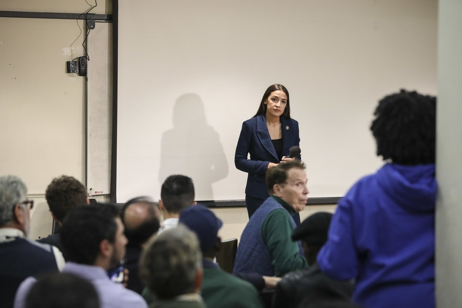 NEW YORK, NY - OCTOBER 03: U.S. Rep. Alexandria Ocasio-Cortez (D-NY) takes questions during a town hall meeting at the LeFrak City Queens Library on October 3, 2019 in the Queens borough of New York City.  The event focused on her A Just Society legislation, which targets poverty, affordable housing, and access to federal benefits. (Photo by Drew Angerer/Getty Images)