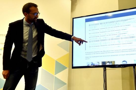 Ukrainian journalist and member of parliament Serhiy Leshchenko points to a monitor displaying allegedly a page of an illegal shadow accounting book of the party of former Ukrainian president Viktor Yanukovych with the signings of payments to Donald Trump's presidential campaign chairman Paul Manafort during a press conference in Kiev on August 19, 2016...The Ukrainian authorities have released line-item entries of payments worth million of dollars that US presidential campaign hopeful Donald Trump's campaign chief allegedly received from the now-ousted Russian-backed leaders in Kiev. The revelations from the National Anti-Corruption Bureau (NABU) on August 18, 2016 were followed on August 19 by claims by a top lawmaker that Paul Manafort lobbied in favour of a pro-Kremlin party even after a February 2014 pro-EU revolt had pulled Ukraine out of Russia's orbit. Manafort served as a public relations adviser to Moscow-backed president Viktor Yanukovych -- now living in self-imposed exile in Russia -- and his Regions party in the former republic between 2007 and 2012. / AFP / SERGEI SUPINSKY        (Photo credit should read SERGEI SUPINSKY/AFP/Getty Images)