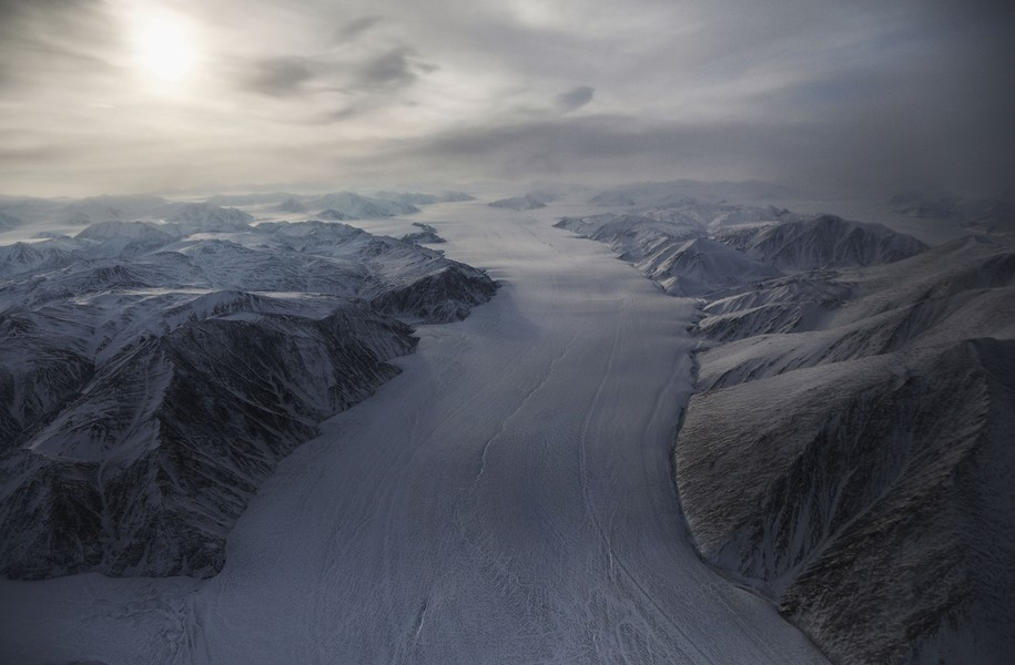 'Like ice cream sliding off a piece of cake,' Greenland ice cap melts in a new and disturbing way.