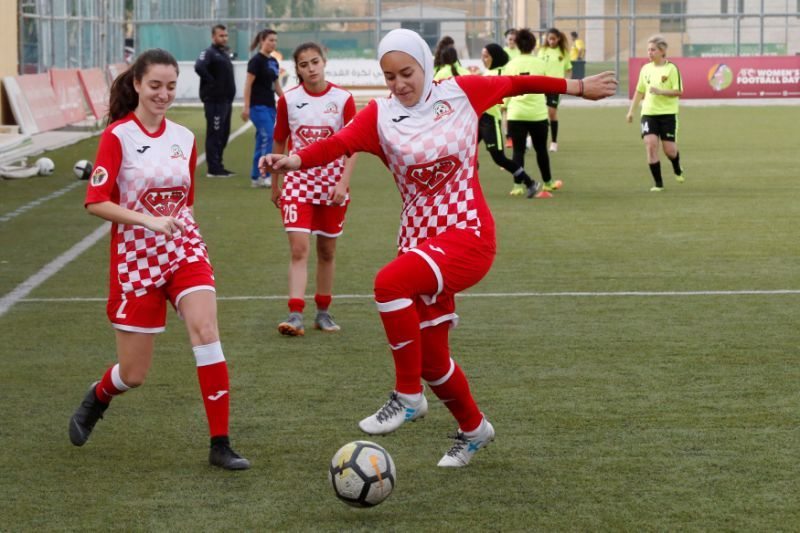 In Championship Soccer Game, A Players Hijab Began To Slip Off. Opponents Rush Over To Protect Her.