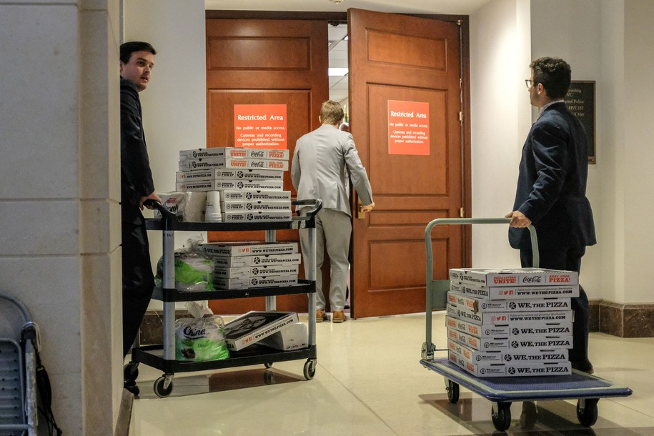 WASHINGTON, DC - OCTOBER 23:  Staffers deliver pizza to a closed session before the House Intelligence, Foreign Affairs and Oversight committees on Capitol Hill on October 23, 2019 in Washington, DC. Deputy Assistant Secretary of Defense Laura Cooper was on Capitol Hill to testify before the committees as part of the ongoing impeachment inquiry against President Donald Trump. (Photo by Alex Wroblewski/Getty Images)
