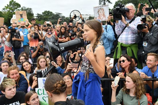 """TOPSHOT - Swedish environment activist Greta Thunberg speaks at a climate protest outside the White House in Washington, DC on September 13, 2019. - Thunberg, 16, has spurred teenagers and students around the world to strike from school every Friday under the rallying cry """"Fridays for future"""" to call on adults to act now to save the planet. (Photo by Nicholas Kamm / AFP)        (Photo credit should read NICHOLAS KAMM/AFP via Getty Images)"""