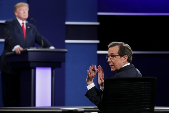 LAS VEGAS, NV - OCTOBER 19:  Fox News anchor and moderator Chris Wallace quiets the audience during the third U.S. presidential debate at the Thomas & Mack Center on October 19, 2016 in Las Vegas, Nevada. Tonight is the final debate ahead of Election Day on November 8.  (Photo by Chip Somodevilla/Getty Images)