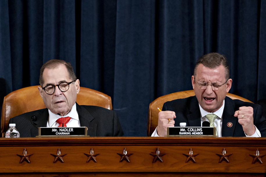 WASHINGTON, DC - DECEMBER 12: Ranking member Rep. Doug Collins (R-GA) (R) speaks as House Judiciary Committee Chairman Jerry Nadler (D-NY) listens during a House Judiciary Committee markup hearing on the Articles of Impeachment against President Donald Trump at the Longworth House Office Building on Thursday December 12, 2019 in Washington, DC. The articles of impeachment charge Trump with abuse of power and obstruction of Congress. House Democrats claim that Trump posed a 'clear and present danger' to national security and the 2020 election in his dealings with Ukraine over the past year. (Photo by Andrew Harrer - Pool/Getty Images)