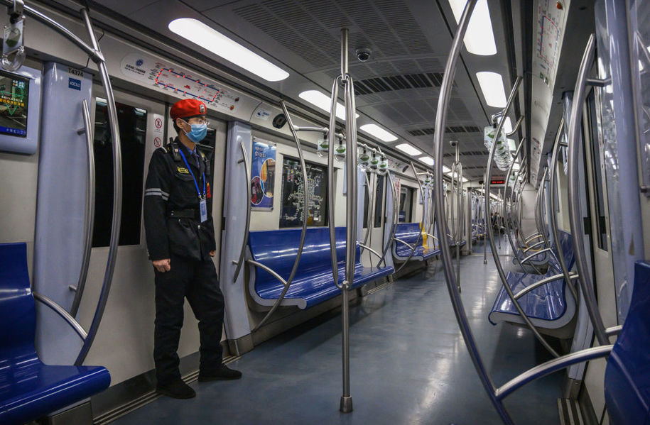 BEIJING, CHINA - FEBRUARY 14: A Chinese security guard wears a protective mask as he stands in a nearly  empty subway car during rush hour on February 14, 2020 in Beijing, China. The number of cases of the deadly new coronavirus COVID-19 rose to more than 55000 in mainland China Friday, in what the World Health Organization (WHO) has declared a global public health emergency. China continued to lock down the city of Wuhan in an effort to contain the spread of the pneumonia-like disease which medicals experts have confirmed can be passed from human to human. In an unprecedented move, Chinese authorities have maintained and in some cases tightened the travel restrictions on the city which is the epicentre of the virus and also in municipalities in other parts of the country affecting tens of millions of people. The number of those who have died from the virus in China climbed to over 1380 on Friday, mostly in Hubei province, and cases have been reported in other countries including the United States, Canada, Australia, Japan, South Korea, India, the United Kingdom, Germany, France and several others. The World Health Organization has warned all governments to be on alert and screening has been stepped up at airports around the world. Some countries, including the United States, have put restrictions on Chinese travellers entering and advised their citizens against travel to China. (Photo by Kevin Frayer/Getty Images)