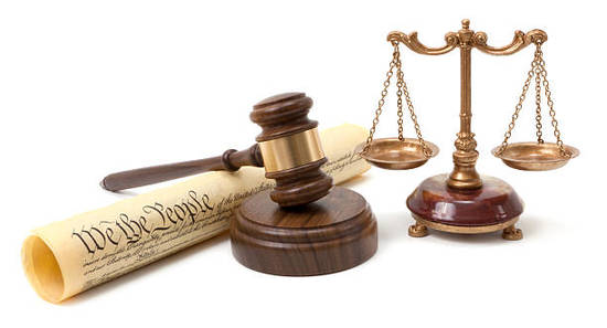 Gavel, the Constitution and scales of justice.