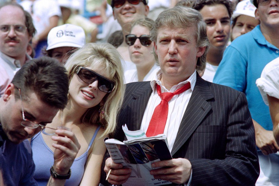 Developer Donald Trump (R) and his fiancee Marla Maples watch second round action at the US Open tennis tournament on August 28, 1991.   AFP PHOTO TIMOTHY A. CLARY        (Photo credit should read TIMOTHY A. CLARY/AFP via Getty Images)