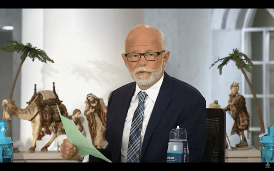 Jim Bakker reads from his list of predictions for the future that he claims God delivered to him while he was in prison. Bakker was convicted of 24 federal counts of fraud and conspiracy in 1989.