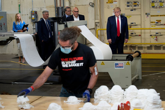US President Donald Trump tours a Honeywell International Inc. factory producing N95 masks during his first trip since widespread COVID-19 related lockdowns went into effect May 5, 2020, in Phoenix, Arizona. (Photo by Brendan Smialowski / AFP) (Photo by BRENDAN SMIALOWSKI/AFP via Getty Images)