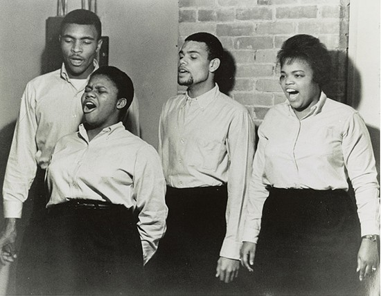 Photograph shows the Freedom Singers, (from l. to r.) Charles Neblett, Bernice Johnson Reagon, Cordell H. Reagon, and Rutha Mae Harris, singing at the Caffè Lena in Saratoga Springs, New York, in 1963.