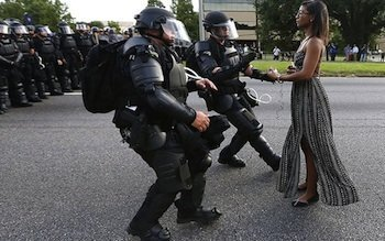 They wanted her to flinch, beg, to break as they used police batons on her. She would not.
