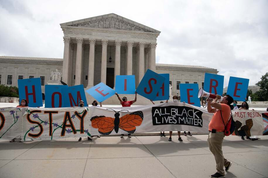 Activists hold a banner in front of the US Supreme Court in Washington, DC, on June 18, 2020. - The US Supreme Court rejected President Donald Trump's move to rescind the DACA program that offers protections to 700,000 undocumented migrants brought to the US as children. (Photo by NICHOLAS KAMM / AFP) (Photo by NICHOLAS KAMM/AFP via Getty Images)