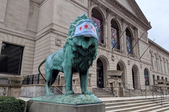 Masked lion in front of the Art Institute of Chicago by photographer Brian Rich at the Chicago Sun Times
